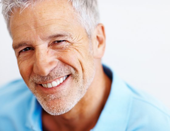 a smilling old man with white hair